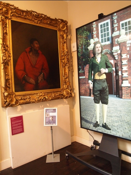 Wilberforce stands beside the Captive Slave portrait.